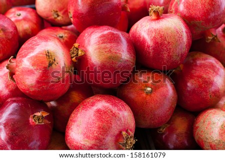 Fresh Pomegranates at Farmers market - stock photo