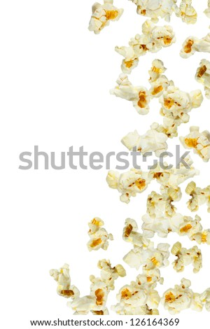 Fresh popcorn falling, close up - stock photo