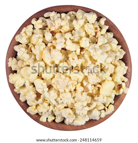 Fresh popcorn in a wooden bowl on a white background - stock photo