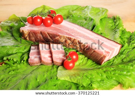 Fresh pork bacon spices, lettuce and tomato - stock photo