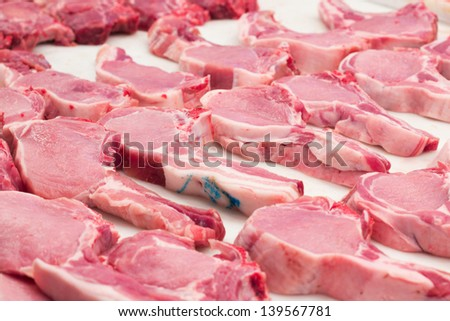 Fresh pork chops on a market stand. - stock photo