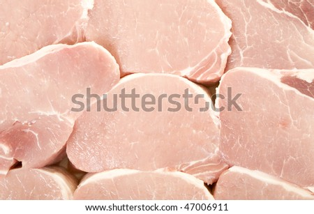 Fresh pork meat pieces background, close up, macro view - stock photo