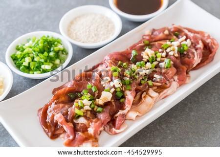 fresh pork sliced with ingredients - stock photo