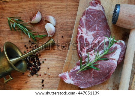 Fresh pork steak meat with herbs. View from above - stock photo