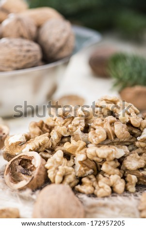 Fresh portion of Walnuts on brigth background - stock photo
