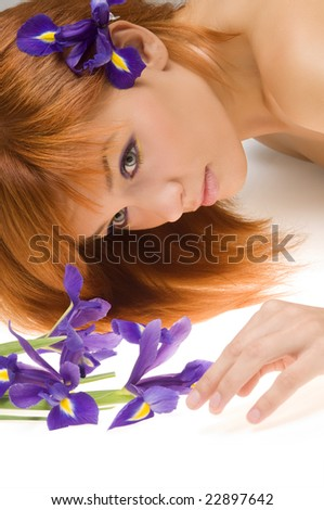 fresh portrait of beautiful young model laying near flower