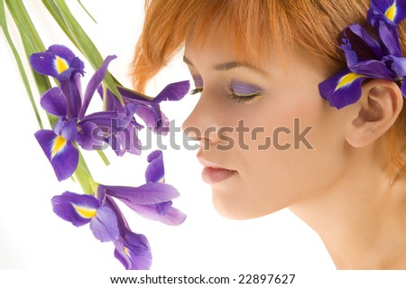 fresh portrait of cute redhead near purple flower with close eyes