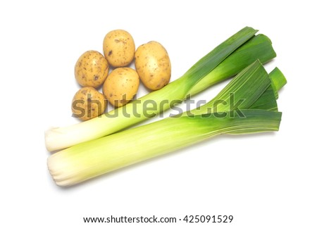 Fresh potatoes and leeks isolated on white background, shot from above