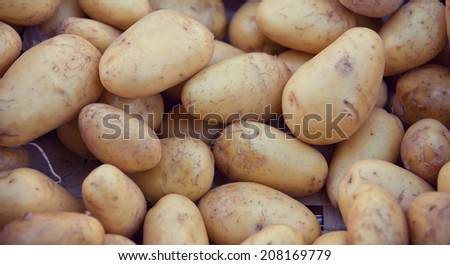 Fresh potatoes at market stall