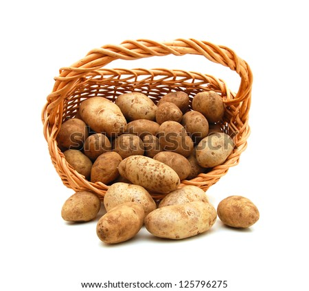 Fresh potatoes in a basket isolated on white