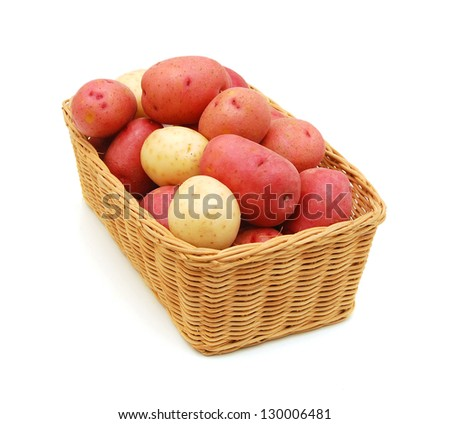 fresh potatoes in a basket isolated on white - stock photo