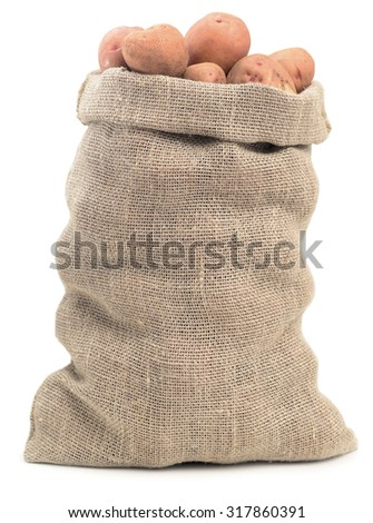 fresh potatoes in sack isolated on white background - stock photo