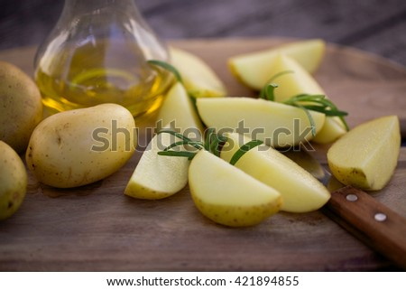 Fresh potatoes, olive oil and rosemary for baking