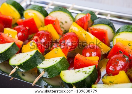 Fresh prepared vegetable skewers with tomato, pepper and zucchini