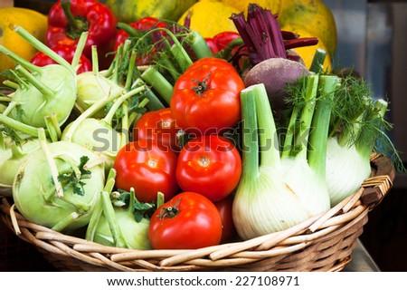 Fresh produce in wicker basket from local farmer's market. - stock photo