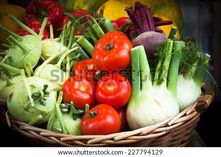 Fresh produce in wicker basket from local farmer's market. Mediterranean diet. - stock photo