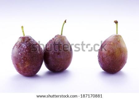 Fresh prunes - stock photo