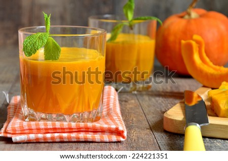 Fresh pumpkin juice in a glass. - stock photo