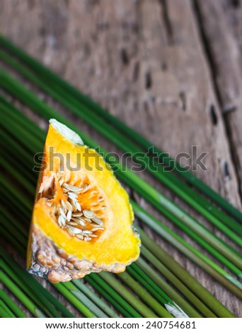 Fresh Pumpkin on Wood Table - stock photo