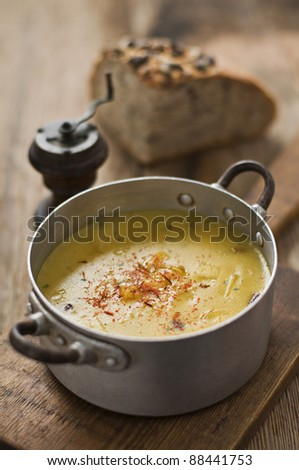 Fresh pumpkin soup on wooden table close up - stock photo
