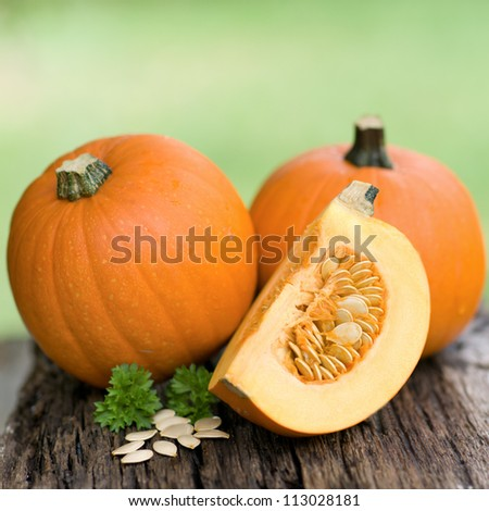 Fresh pumpkins on wooden ground - stock photo