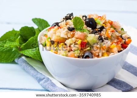 fresh quinoa salad taboule style with vegetables on bowl - stock photo
