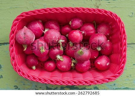 Fresh radish in red basket, top view - stock photo