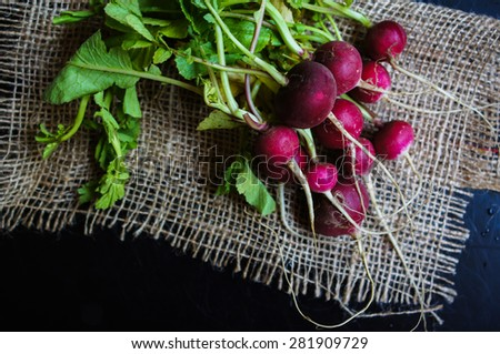 Fresh radish vegetable on wooden background - stock photo