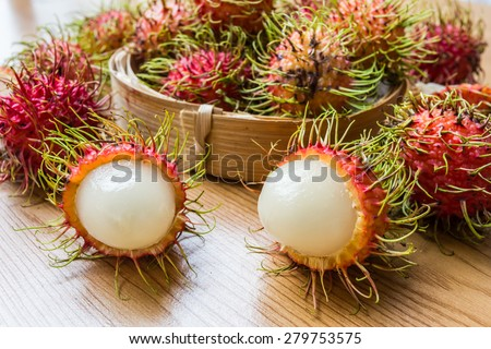 Fresh rambutan on wood background - stock photo