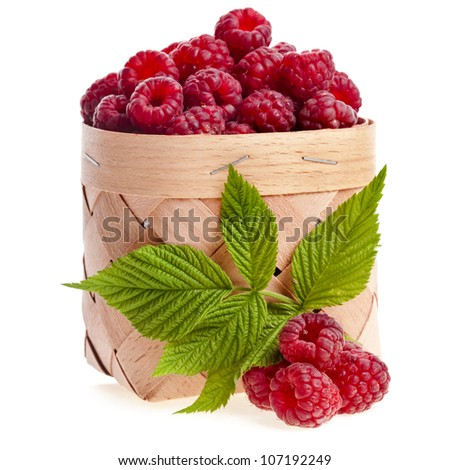 fresh raspberries in the wooden basket close up isolated on white background - stock photo