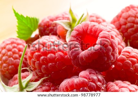 Fresh raspberries in white bowl