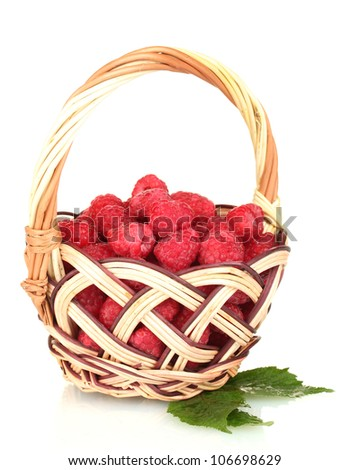 Fresh raspberries in wicker basket isolated on white