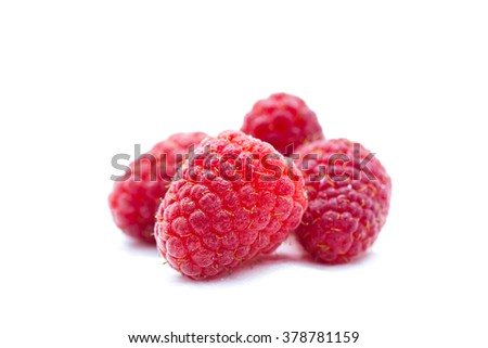 Fresh raspberries isolated on a white background.