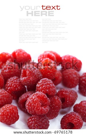 fresh raspberries over white (easy removable text) - stock photo
