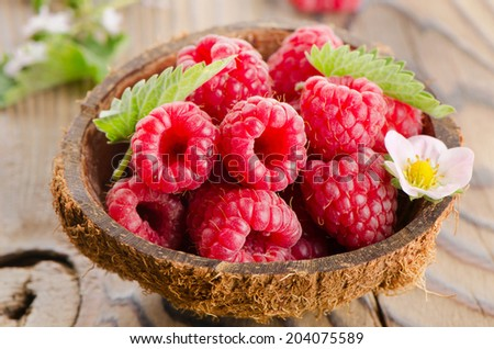 Fresh raspberries  with leaves . Selective focus - stock photo