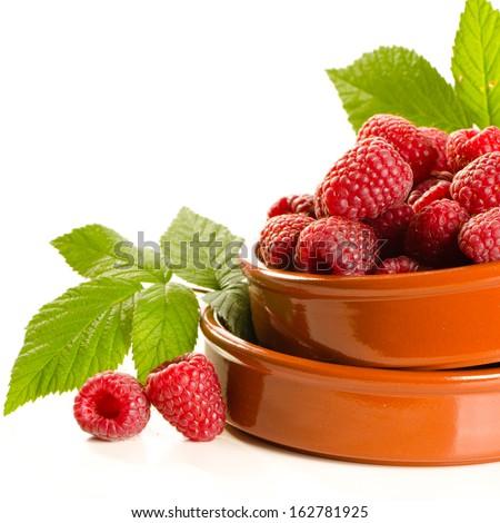 Fresh raspberry in the bowl macro isolated on white - stock photo