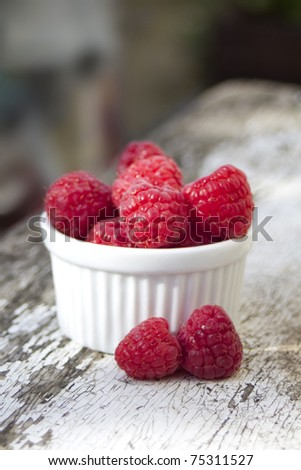 Fresh Raspberry on old wooden table - stock photo