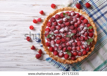 Fresh raspberry tart with cream cheese and mint. horizontal top view