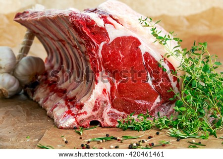 Fresh Raw Beef bone rib roughly choppid. with herbs. - stock photo