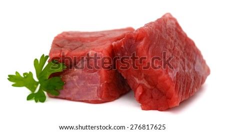 fresh raw beef cubes and parsley on white background  - stock photo