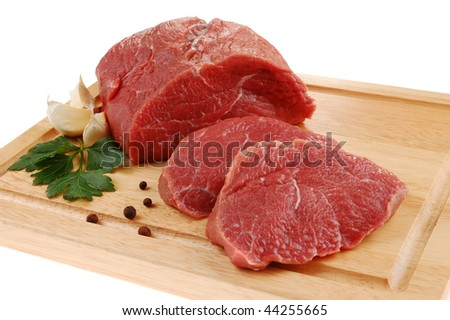 Fresh raw beef on cutting board - stock photo