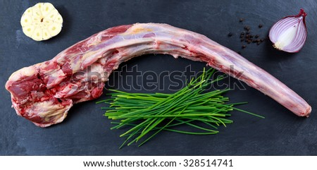 Fresh Raw Beef Oxtail Meat Ready To Cook On Blue Stone Background