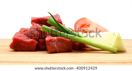 Fresh Raw Beef Sliced On Wooden Cutting Board