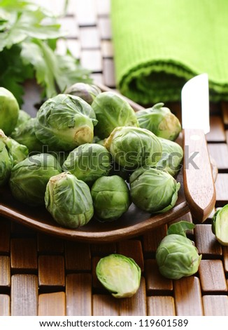 fresh raw brussels sprouts on a wooden table - stock photo