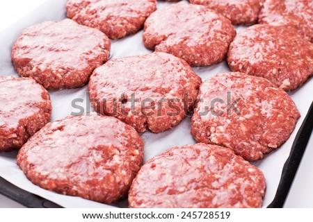 Fresh raw burger cutlets  - stock photo