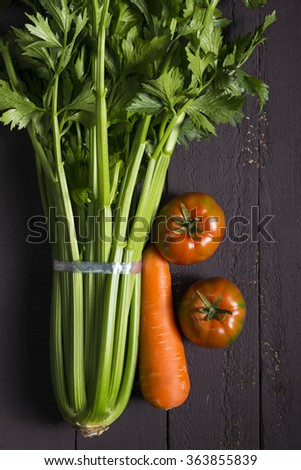 Fresh Raw Celery, Carrots and Tomatoes Vegetable on Brown Wooden