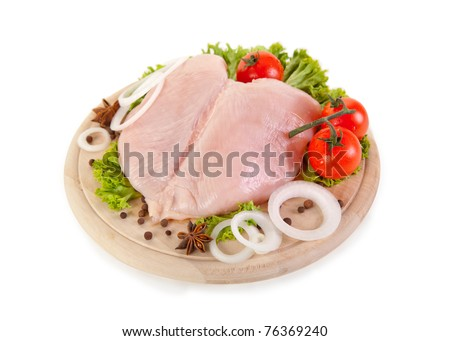 Fresh raw chicken breasts with vegetables, clipping path included - stock photo