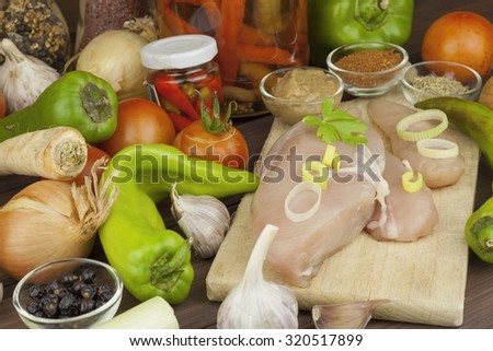 Fresh raw chicken fillet and vegetables prepared for cooking. Fresh raw chicken breasts. Preparing chicken at a summer barbecue. Cooking with fresh dietary ingredients. Preparing Diet food. - stock photo