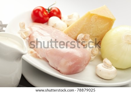 Fresh raw chicken fillets with vegetables