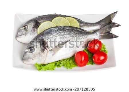Fresh raw fish isolated on white - stock photo
